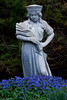 garden statuary, The Wheat Girl with pulmonaria, or Lungwort, coastal Maine garden, spring