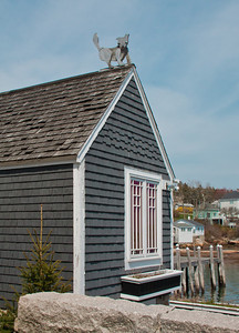 Stonington, Maine, wooden dog folk art on roof