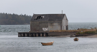 Abandoned fishing wharf with yellow dories, Lubec Maine. North Atlantic, Downeast Maine scenic