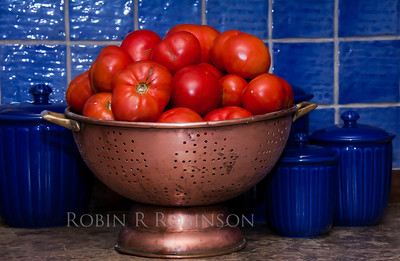 tomatoes at harvest, copper colander and blue canisters and tile, my kitchen