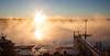 Sea smoke rising over Cape Small Harbor, sunrise, Phippsburg, Maine, January.