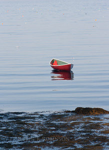 Red boat at sunrise, Phippsburg, Maine. The little dots in the background are all lobster pot bouys! What a mine field to negotiate by boat!