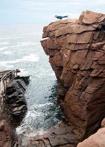 "Thunder Hole, named for the loud booming made when water is forced with in coming tide upward and through the narrow gut of rocks, a famous feature of Acadia National Park area, Mount Desert Island, Maine in September, an iconic popular tourist destination. I call this image ""The Balancing Man."""
