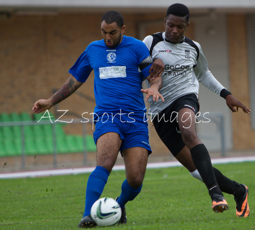 Christiaan Beaupierre  beats a Stansted forward to the ball