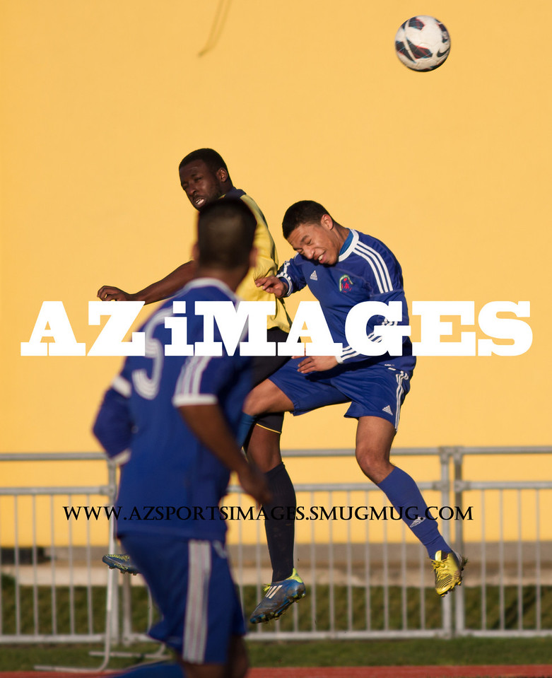 APSA's KEITH OPPONG and Sporting's MICHEAL WILLIAMS in a heading duel