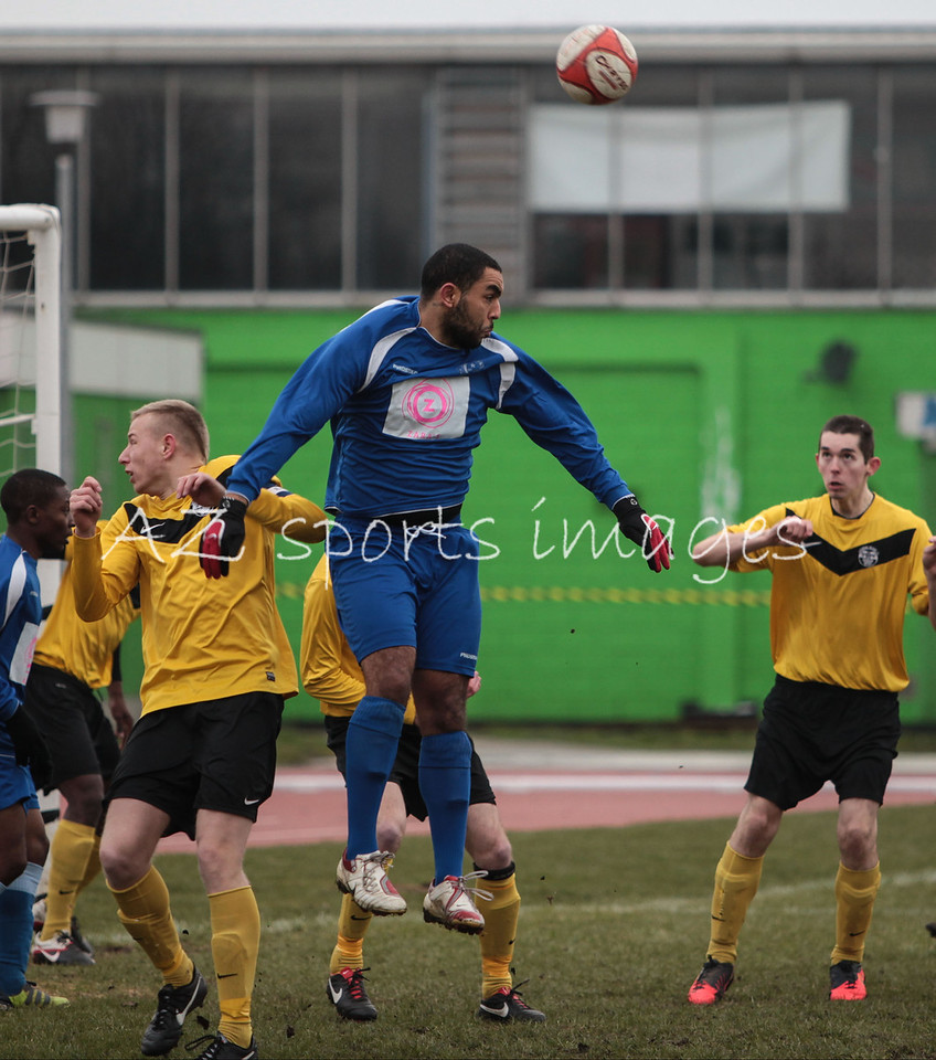 APSA's Christian Beaupierre wins a header against manors Terry Griffith