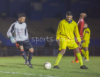 Center Half Liton Zaman looks on as his keeper Sham Zaman comes to collect the ball