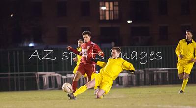 Aaron Hutchings puts in a last ditch tackel on London Bari midfielder Zaeem Husyin