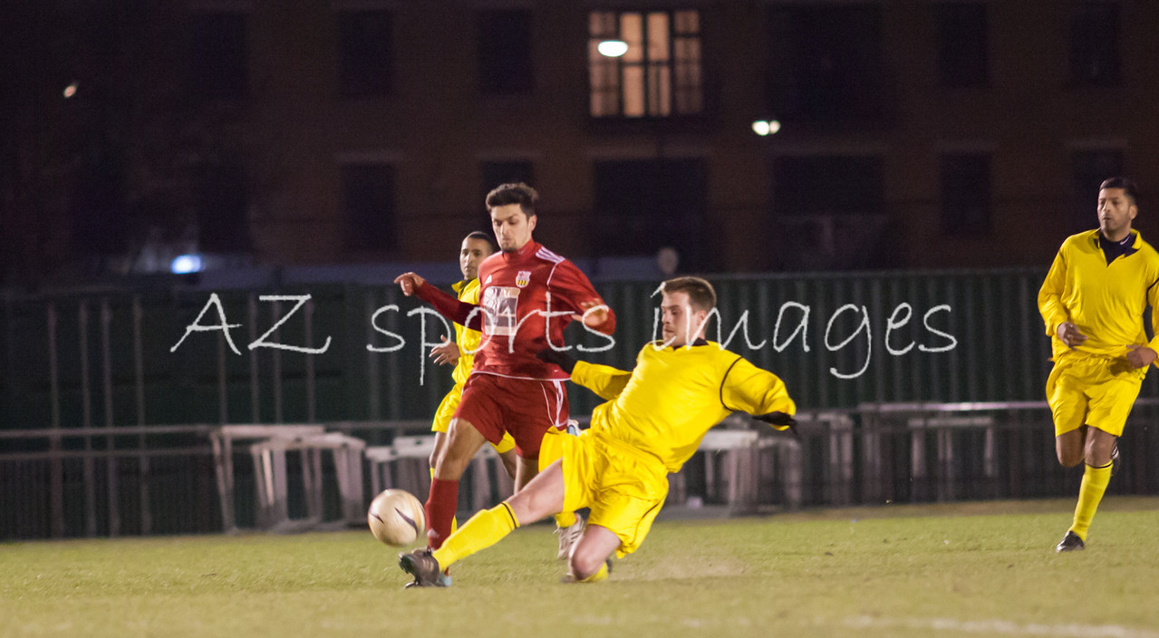 Aaron Hutchings puts in a last ditch tackel on London Bari midfielder Zaeem Husyin