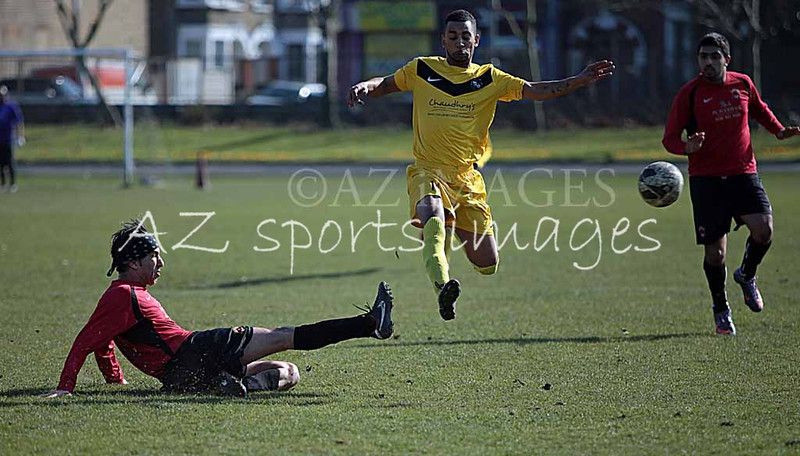 Red Star Captain Tehir makes a sliding tackel on FCL's Bradley Williams