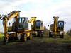 Quatro Road Railers<br /> <br /> Location: Bescar Lane station <br /> <br /> Date: 18th Oct 2012 <br /> <br /> Rear left: Komatsu 160 -3 Euro # 940664 -4 fleet # 700 <br /> <br /> Rear Right:  Komatsu 160 -3 Euro # 940620-6<br /> <br /> Front Left: Case 170 Euro # 940371-6