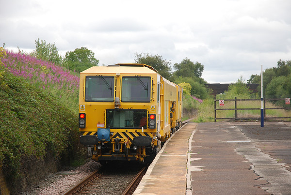Colas Plasser & Theurer 08-4x4/4S-RT Switch & Crossing Tamper  Location: Denton Station   Date 8th July 011   Going away shot of the Tamper following on behind 2J45 09.22 Stockport - Stalybridge Ghost train heading for Guide Bridge OTPD Depot