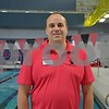 Matt Anderson, senior head coach of the DeKalb County Swim Team, poses for a photo in front of a pool at the Kishwaukee Family YMCA.