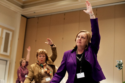 Dorthey Schey (right), Gwen Weiche (center) and Amy Whitney (left) participate in a group yoga session during the Women in Philanthropy conference on Thursday, March 14th in Baker Ballroom. Photo by: Ross Brinkerhoff.