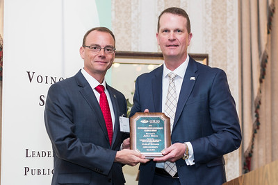 Craig Butler, left, and John Born pose for a photo with Born's Outstanding State Government Alumnus Award during the Ohio University State Government Alumni Luncheon on Tuesday, May 5, 2015.  Photo by Ohio University  /  Rob Hardin