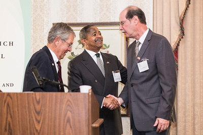 Ohio University President Roderick McDavis congratulates Voinovich School founding dean Mark Weinberg after former Senator George Voinovich's announcement of the newly endowed scholarhsip in Weinberg's honor at the Ohio University State Government Alumni Luncheon on Tuesday, May 5, 2015.  Photo by Ohio University  /  Rob Hardin