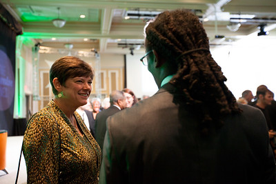 Sandy Anderson speaks with a student after the Promise Lives Campaign Celebration Gala on Friday, Sept. 11, 2015. Photo by Kaitlin Owens