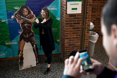 "LANCASTER, OHIO   MARCH 23, 2018: Michelle Poler, founder of Hello Fears, gets her picture taken standing beside a cutout of Wonderwoman during the Celebrate Women Conference 2018, themed ""Recognizing Our Superpowers"" on March 23, 2018 at Ohio University Lancaster in Lancaster, Ohio.  Ty Wright photo"