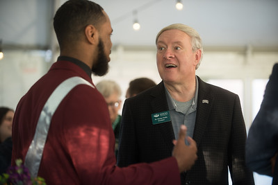 Alumni Awards 2018 awardees, Homecoming Court, OHIO Alumni Association staff, and University leadership mingle at a private reception in Peden parking lot.