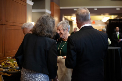 2018 Alumni Awards guests surveyed the offerings at the buffet table outside the Baker Center Ballroom. Photo by Ellee Achten