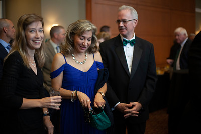 Attendees of the 2018 Alumni Awards waited their turn at the bar outside the Baker Ballroom. Photo by Ellee Achten