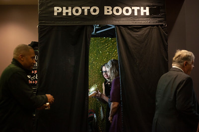 2018 Alumni Awards Gala attendees tried on props in the photo booth stationed outside Baker Center Ballroom during Homecoming Week. Photo by Ellee Achten