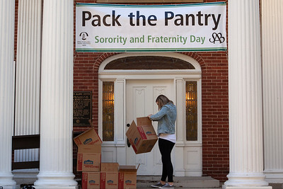 An OU student and volunteer for the Pack the Pantry event inspects the boxes in preparation for receiving canned goods. photo by: Ellee Achten