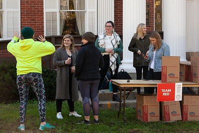 Volunteers from various sororities and the Student Alumni Board chatted excitedly minutes before the Pack the Pantry canned-good competition was officially open, during Homecoming Week at OU. photo by: Ellee Achten