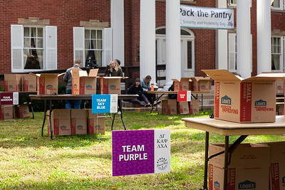 Boxes are scattered across tables set up in front of Konneker Alumni Center for OU's Homecoming Week Pack the Pantry event. photo by: Ellee Achten