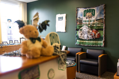 Participants in the Dean of Students Office's (Baker 345) entry for the Paint the Town Green event displayed their personal Ohio decorations in the lobby of the office.