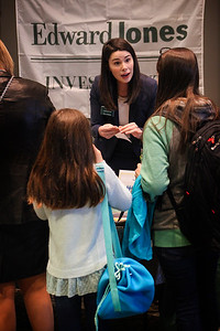 Tessa Carpenter with Edward Jones Investments, talks to a mother and daughter attending the 13th Annual Celebrate Women Conference in Lancaster, Ohio on March 22, 2019.
