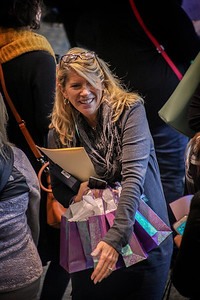 Candice Thomas-Maddox navigates the morning crowd with gift bags at the 13th Annual Celebrate Women Conference in Lancaster, Ohio, on March 22, 2019.