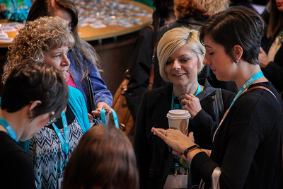 Attendees--mostly women--of the 13th Annual Celebrate Women Conference greet each other during the registration and networking hour on March 22, 2019.