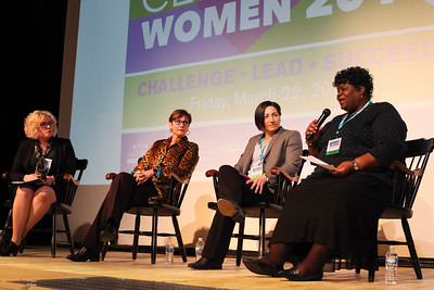 Laurie Sheridan Lach (left), Jennifer Friel (left-center), and Heather Lawrence-Benedict, listen as Cynthia Calhoun encourages the audience at the 13th Annual Celebrate Women Conference on March 22, 2019.