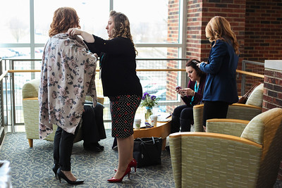 A friend (center) helps Angela Snider (left)--a recipient of the 2018 Jane Johnsen Women of Vision Award--adjust her wrap during the 13th Annual Celebrate Women Conference.
