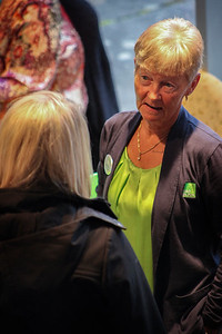 An H&R Block representative greets 2019 Celebrate Women Conference attendees at a brightly displayed table during registration at the Ohio University Lancaster campus on March 22, 2019.