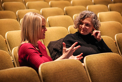 Becky Brooks (left), a sign interpreter with Ohio University Communication Sciences and Disorders, uses her hands to chat with a 13th Annual Celebrate Women Conference attendee just before she worked to interpret the day's panel discussion.