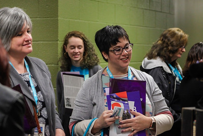 Attendees of the 13th Annual Celebrate Women Conference in Lancaster, Ohio, scan the vendors tables during the registration hour on March 22, 2019.