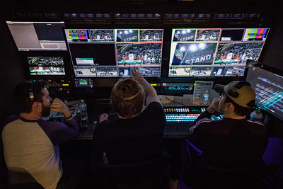 Photo by Max Catalano, BSVC 20'   (Left to right) Producer Noah Wolf, director Colton Wheeler and technical director Jakob Evans run the control room where they decide which camera is in operation and talk directly with ESPN to ensure smooth broadcasting.