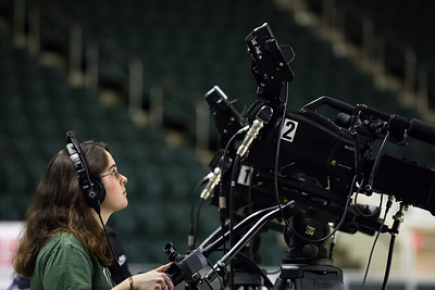 Photo by Max Catalano, BSVC 20'   Raegan Williams from Ohio University Southern campus sets up the ESPN broadcasting cameras before the night's basketball game.