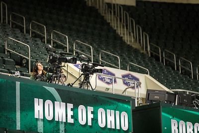 Photo by Max Catalano, BSVC 20'   Raegan Williams from Ohio University Southern campus sets up the ESPN broadcasting cameras before the night's basketball game.  INTRO: Students from Ohio University's southern campus visit the Convo to run the broadcast of ESPN3's coverage of the OU vs. Eastern Michigan men's Basketball game on February 12, 2019. Students arrive at the Convo four hours before the game starts to prepare for the event. They collaborate with students from Athens's campus and gain live production experience working with industry-standard gear.