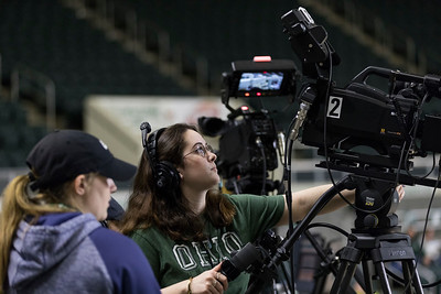 Photo by Max Catalano, BSVC 20'   (Left to right) Claire Geary from Ohio University and Raegan Williams from Ohio University's Southern campus operate ESPN's broadcasting cameras for the February 12, 2019 basketball game versus Eastern Michigan.