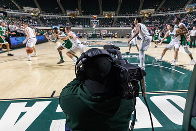 Photo by Max Catalano, BSVC 20'   Bryan McGlone from Ohio University's Southern campus operates the lower level camera for the ESPN broadcast of OU vs. Eastern Michigan on February 12, 2019.