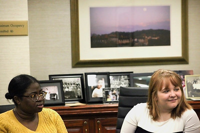 Mietta Smith (left) and Heather Aycock (right), both freshman in the music program at Ohio University, listen as conversation begins at a luncheon to honor them as the Isabel Courtney Hall Music Education Scholarship recipients.