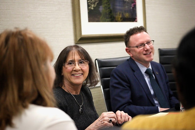 Chris Seigfred (left), a relative of Isabel Courtney Hall and donor for the Isabel Courtney Hall Music Education Scholarship, shares a smile with a recipient at a luncheon honoring the awardees, while College of Fine Arts Dean Matthew Shaftel (right) chats with someone nearby.