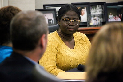 Mietta Smith, a freshman in Ohio University's music program and a recipient of the Isabel Courtney Hall Music Education Scholarship, listens attentively to one of the donors talk about the history behind the scholarship during a luncheon at the Ohio Inn.