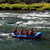 Rafters having fun and keeping cool in the 90 degree heat of the Deschutes River Canyon—Maupin, Oregon.  (9-2012)