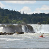 A kayaker enjoys the spectacular view of Willamette Falls that spans 1,700 hundred feet, and has a 42-foot drop.  Oregon City, Oregon.  (2013)