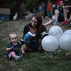 Ashley Teatro of Winchendon sits with daughter Evianna Lavender, 1, while holding four balloons which represent four family members and friends she's lost to opioid addiction, which included her boyfriend, father, uncle and good friend.  During the Second Annual International Overdose Awareness Day in Gardner Wednesday night, residents of surrounding towns came together at Monument Park  to remember family and friends who have suffered the tragic consequences of the opiate epidemic. SENTINEL & ENTERPRISE/JEFF PORTER
