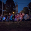 Marsha Gleason of Clinton mourns the loss of a loved one next to Kayla Schaefer of Gardner as images of the victims of the opiate epidemic are presented during a slide show on center stage.  During the Second Annual International Overdose Awareness Day in Gardner Wednesday night, residents of surrounding towns came together at Monument Park  to remember family and friends who have suffered the tragic consequences of the opiate epidemic. SENTINEL & ENTERPRISE/JEFF PORTER